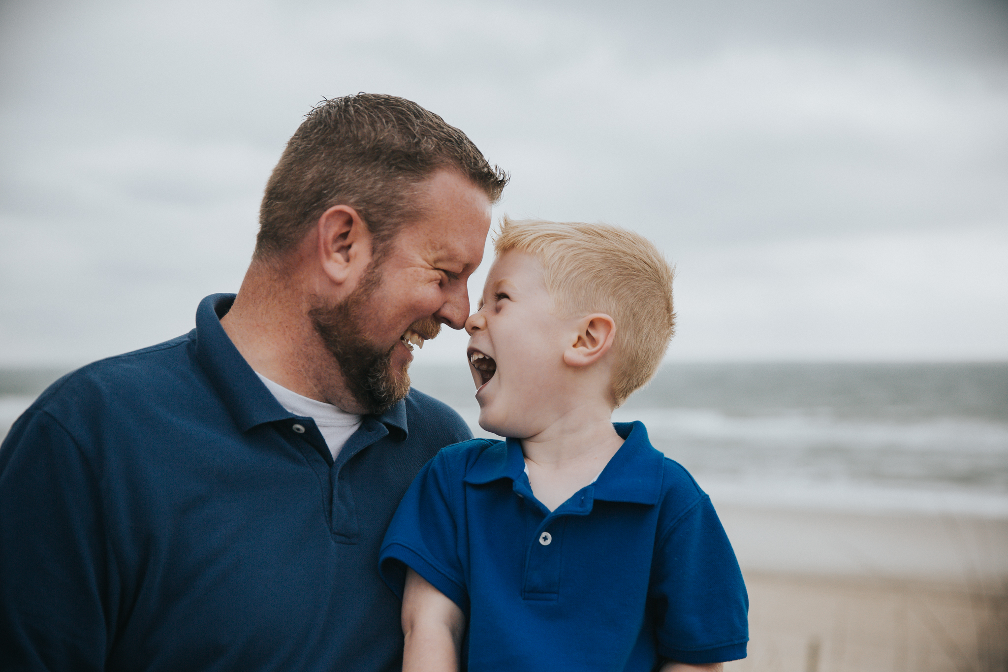 Father and son photograph taken at Carolina Beach by family photographer based in Wilmington NC